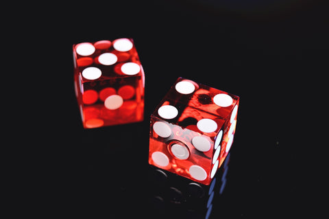 two-red-and-white-dice-on-black-background-momental-nootropics