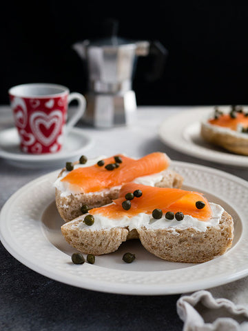 two-slices-of-bread-with-cream-cheese-smoked-salmon-and-capers-on-white-plate-momental-nootropics