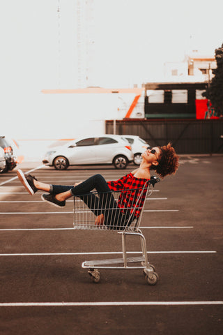 woman-having-fun-in-shopping-cart-momental-nootropics