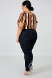 She's a vibrant thing plus sized distressed denim jeans