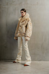 THE NÖELLE REVERSIBLE SHEARLING JACKET IN BLONDIE