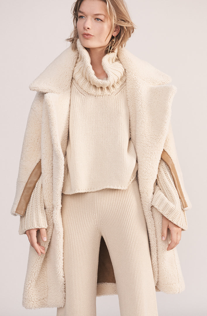 THE COURCHEVAL CASHMERE TURTLE NECK SWEATER
