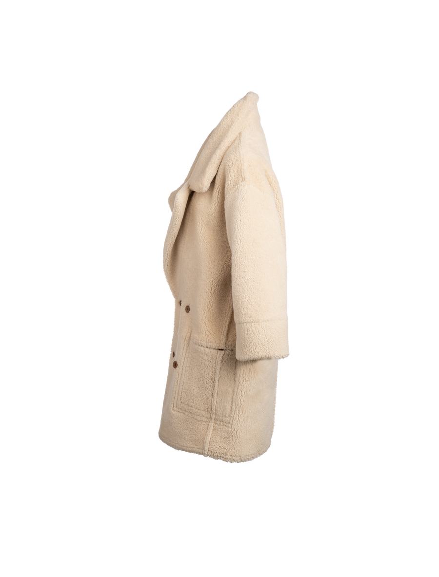 The Amo Reversible Shearling Coat In Camel