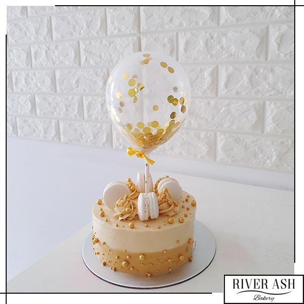 Gold Pearls Gold Confetti Balloon Cake Cake-River Ash Bakery