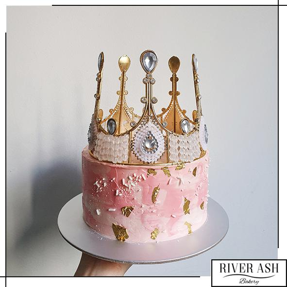 Pink Lady Cake with Gold Crown-River Ash Bakery