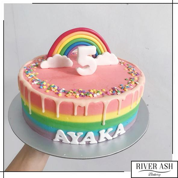 Rainbow Cake with Rainbow Topper-River Ash Bakery