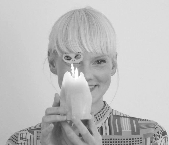 balck and white picture of 54 celsius owner, Thorunn, holding kisa the cat candle.