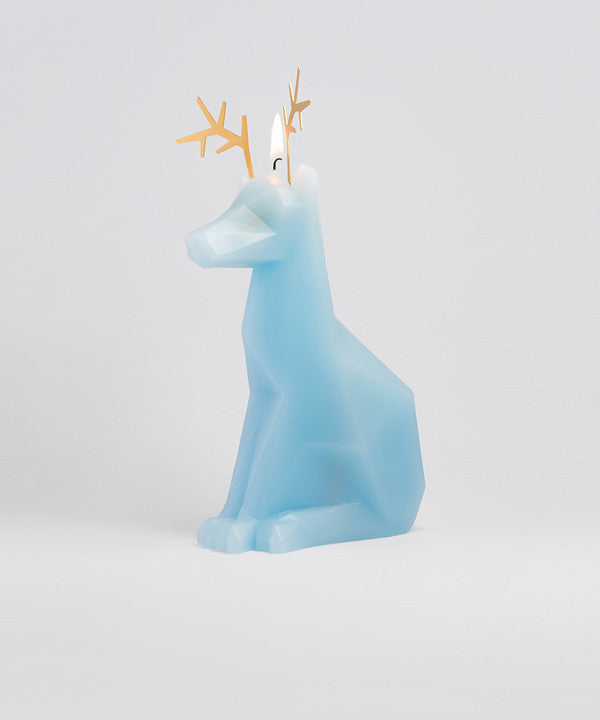 Side view of light-blue Dyri the reindeer shaped pyropet candle with a lit wick.