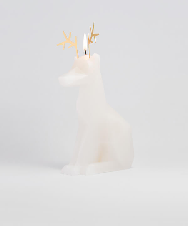 Side view of white Dyri Reindeer animal shaped candle burns to reveal inner skeleton. Perfect decoration for animal lovers.