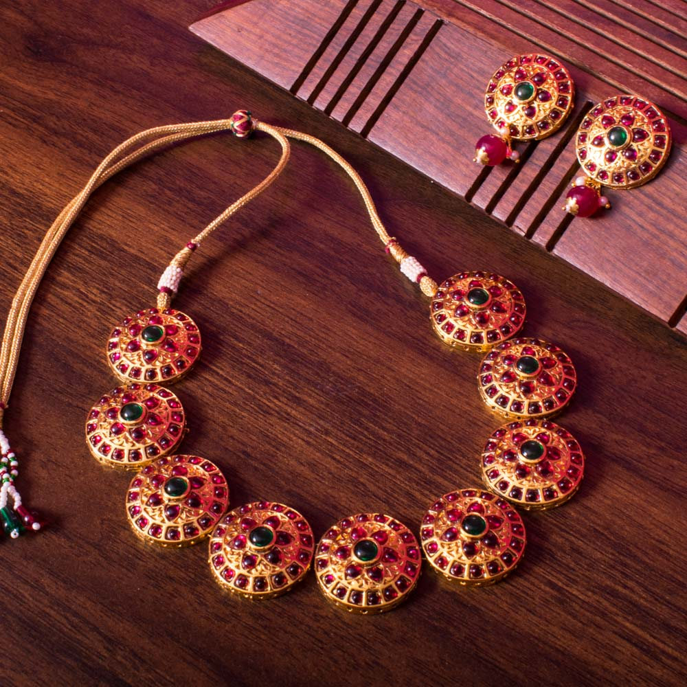 Gold and red necklace