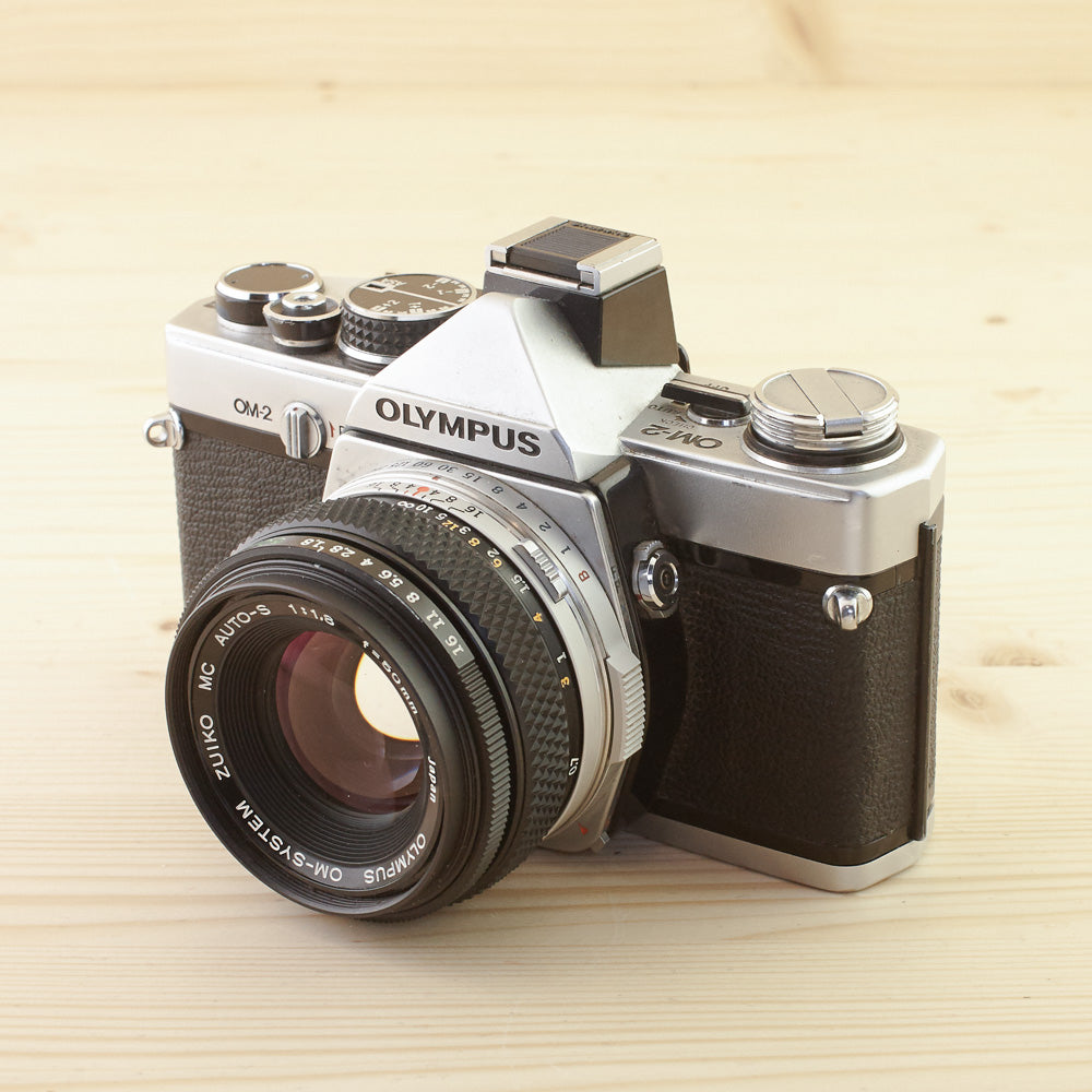 Olympus OM-2 Chrome w/ 50mm f/1.8 Exc - West Yorkshire Cameras
