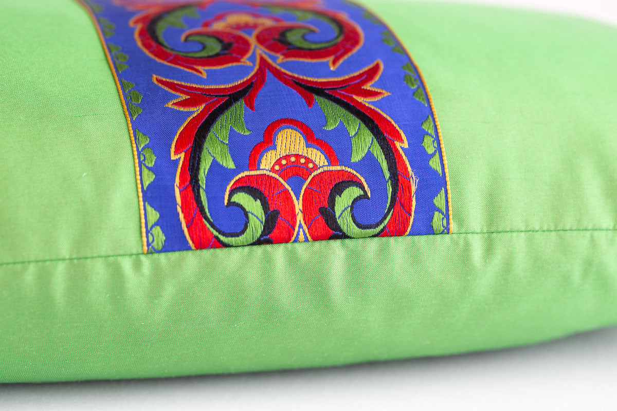 """Exuberant"" green silk cushion"