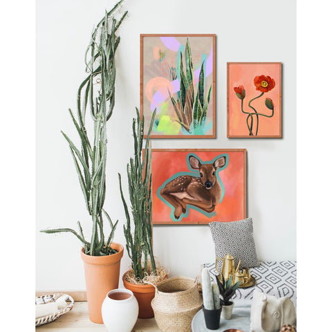 Wall with prints including Fawn Rest Cactus and Poppy painting prints.