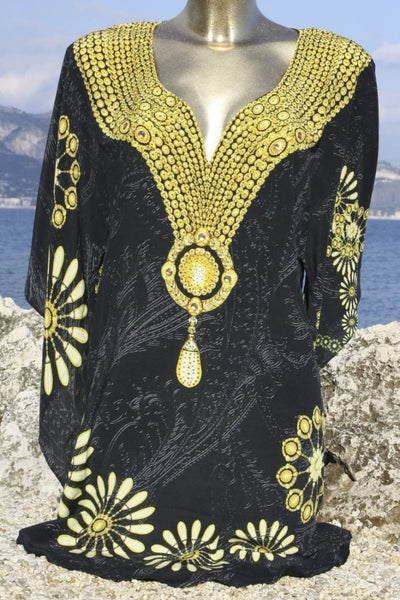 Exquisite black silk tunic gold jewels. Black Diamond