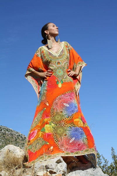 Orange Kaftan bright arabesque flowers. Elegance