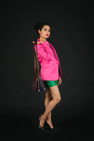 Pink blazer with Miss Sixty green skirt