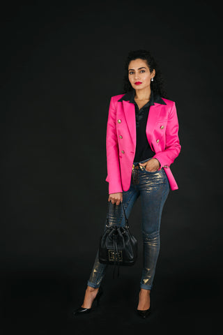 Pink blazer and denim jeans with gold fade