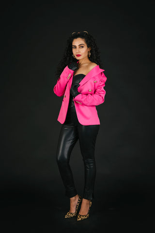 Pink blazer with all-black bustier and trouser