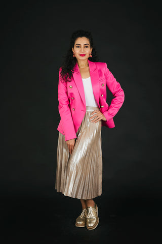 Pink blazer and gold pleated skirt