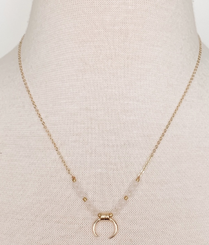 Dainty beaded crescent necklace
