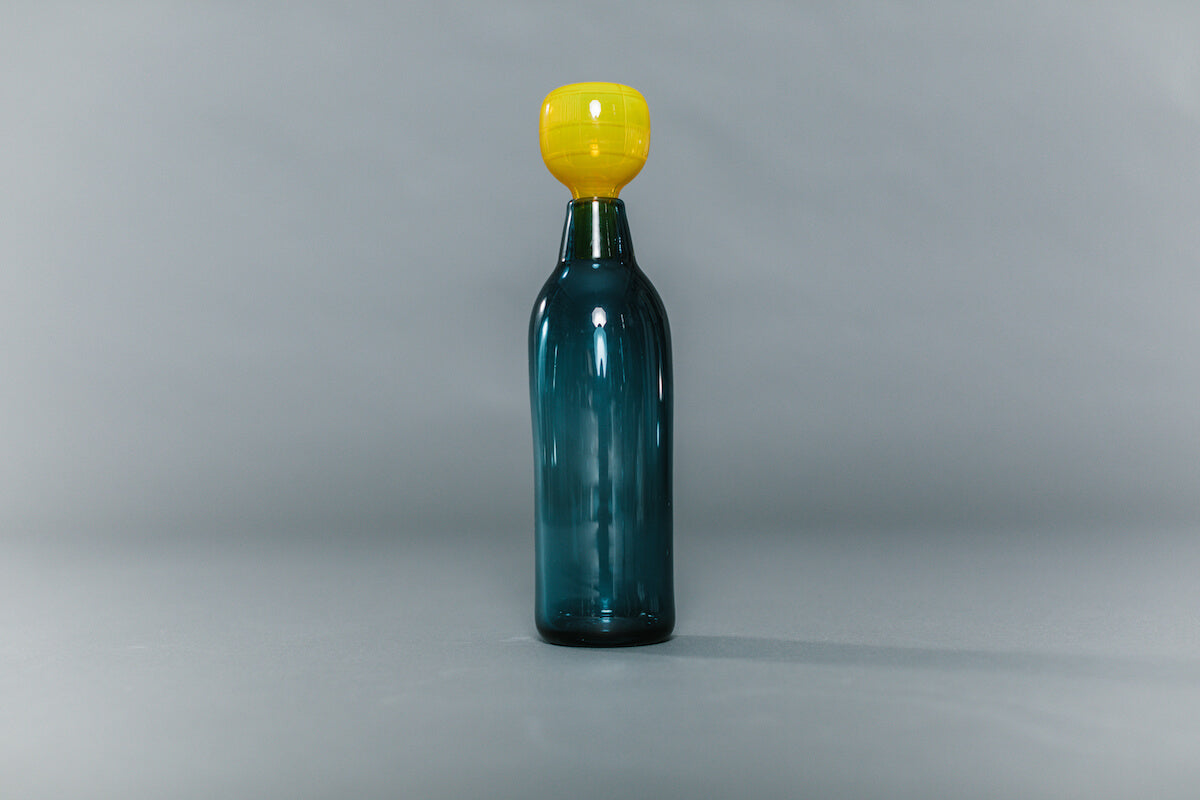 blue glass decanter with yellow glass stopper handblown by Vicky Higginson for AUTHOR