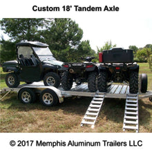 Tandem axle utility trailer with two ATVs and one UTV.
