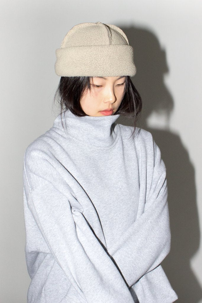 LLOYD Fleece Toque in Pearl. Available at EASE Toronto.
