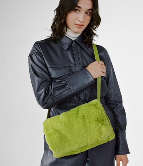 CLYDE Muff Bag in Moss Faux Fur. Available at EASE Toronto.