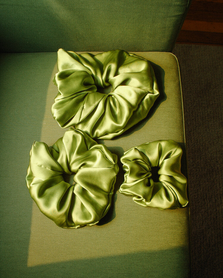 Bronze Age Silk Scrunchie in Avocado. Available at EASE Toronto.