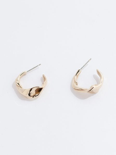 Faris Twist Hoops in Bronze. Available at EASE Toronto.