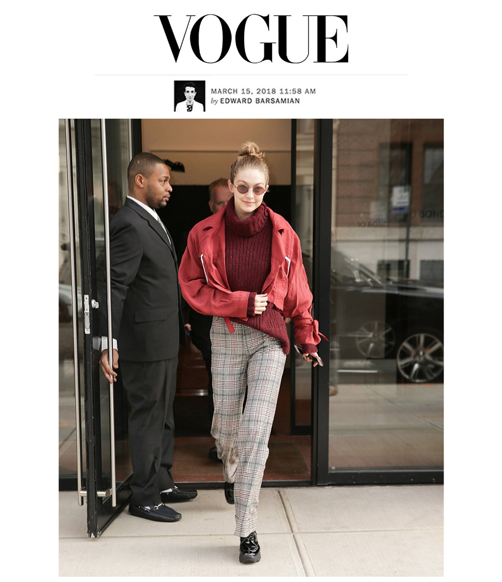MAR 15, 2018 | Gigi Hadid in iRi Black Patent Leather Boot in New York as seen on Vogue