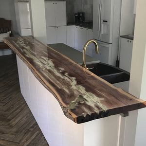 Live Edge Red Cedar Bar Top with Glow in the dark resin made with locally sourced materials from Saint Augustine Florida