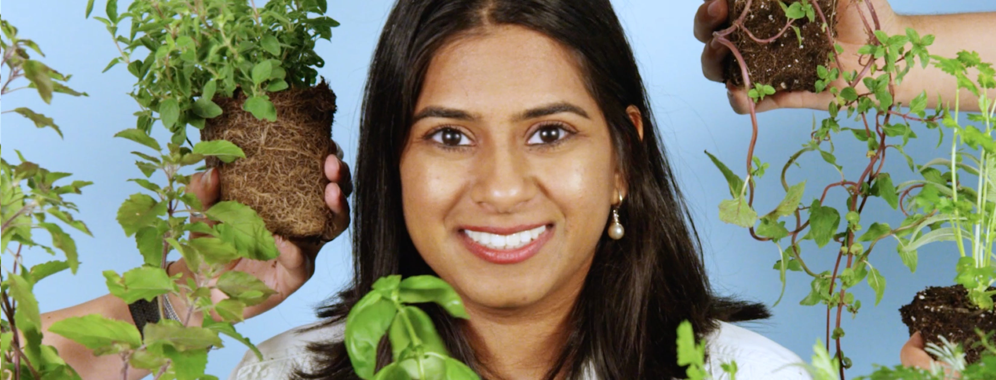 Photo of a woman, surrounded by plants, elated that she can garden worry-free