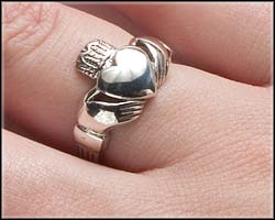 How to wear a Claddagh ring on right hand with heart facing towards you.