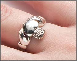 How to wear a Claddagh ring on right hand with heart facing away from you.