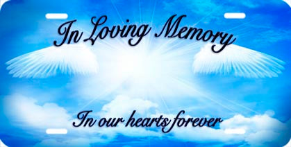 in loving memory auto tag with angelic wings in the clouds on a