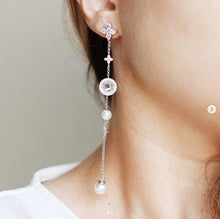 Crystal and pearl symbol asymmetric earrings