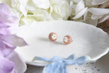 Pink knitted floral studs