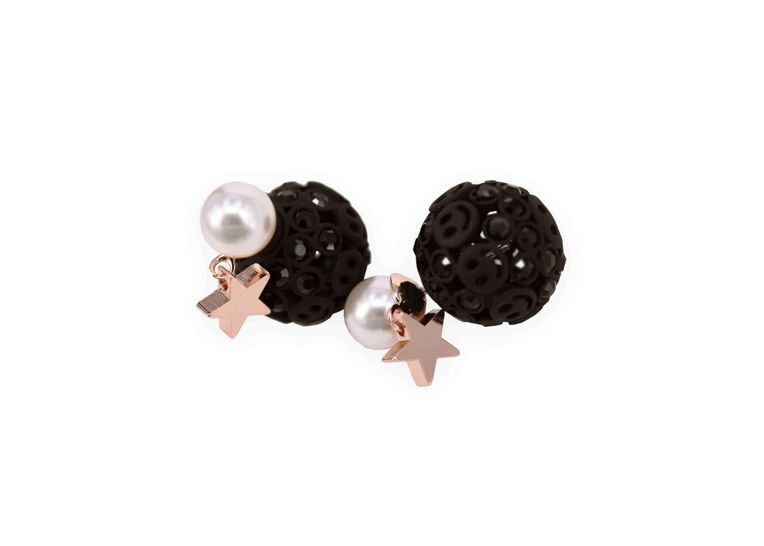 Black round studs with smiley face patterns