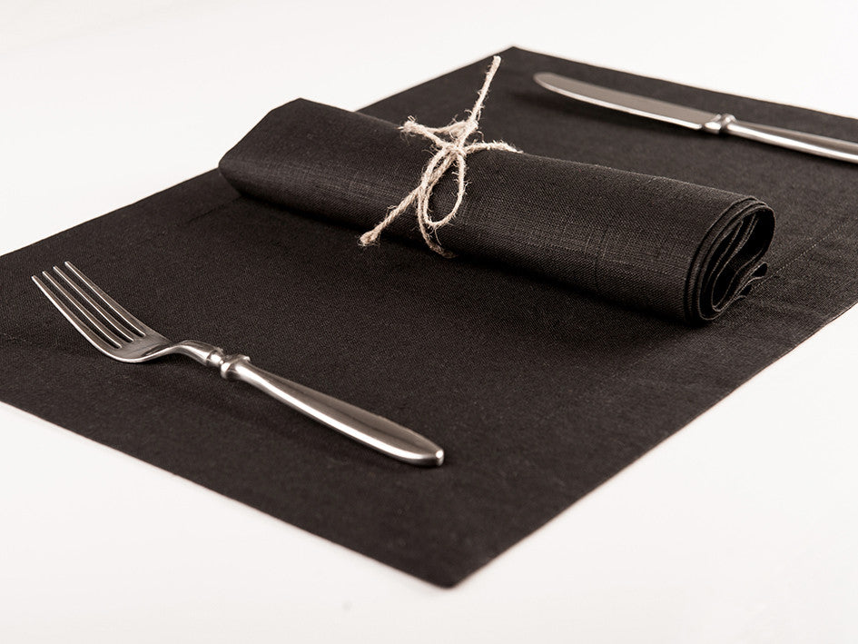 Black linen table napkin and placemat
