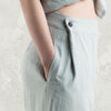 Dove grey linen pants with black buttons