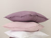 Light purple dusty rose and white linen decorative pillows