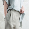 Natural linen pants with black buttons