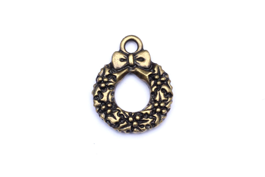 Brass Christmas charm.  Ideal for jewellery making and other festive crafts.