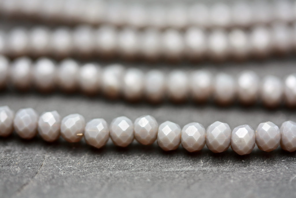 String of 3 x 4 mm opaque grey faceted glass rondel beads.