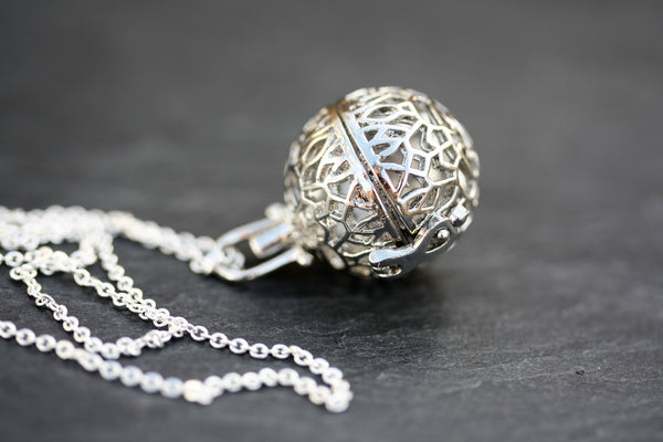 Small silver diffuser necklace with lava ball. Gift set available with doTerra essential oils.