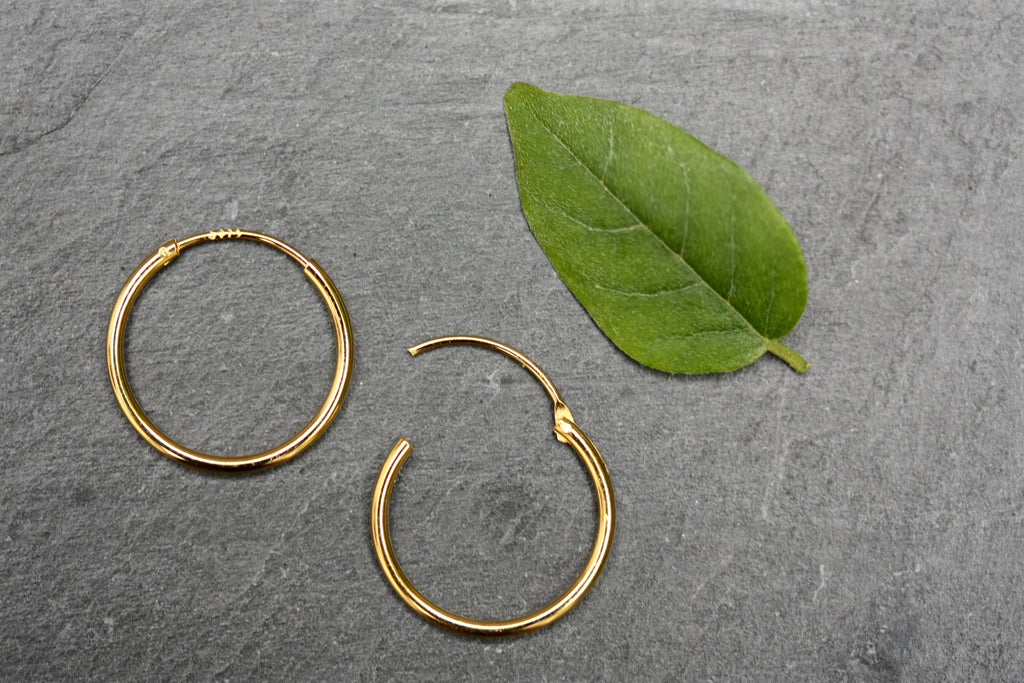 15mm plain sterling silver gold plated hoops.