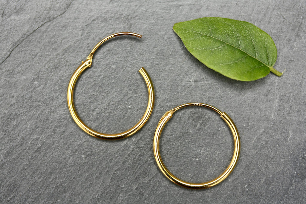 20mm plain sterling silver gold plated hoops.