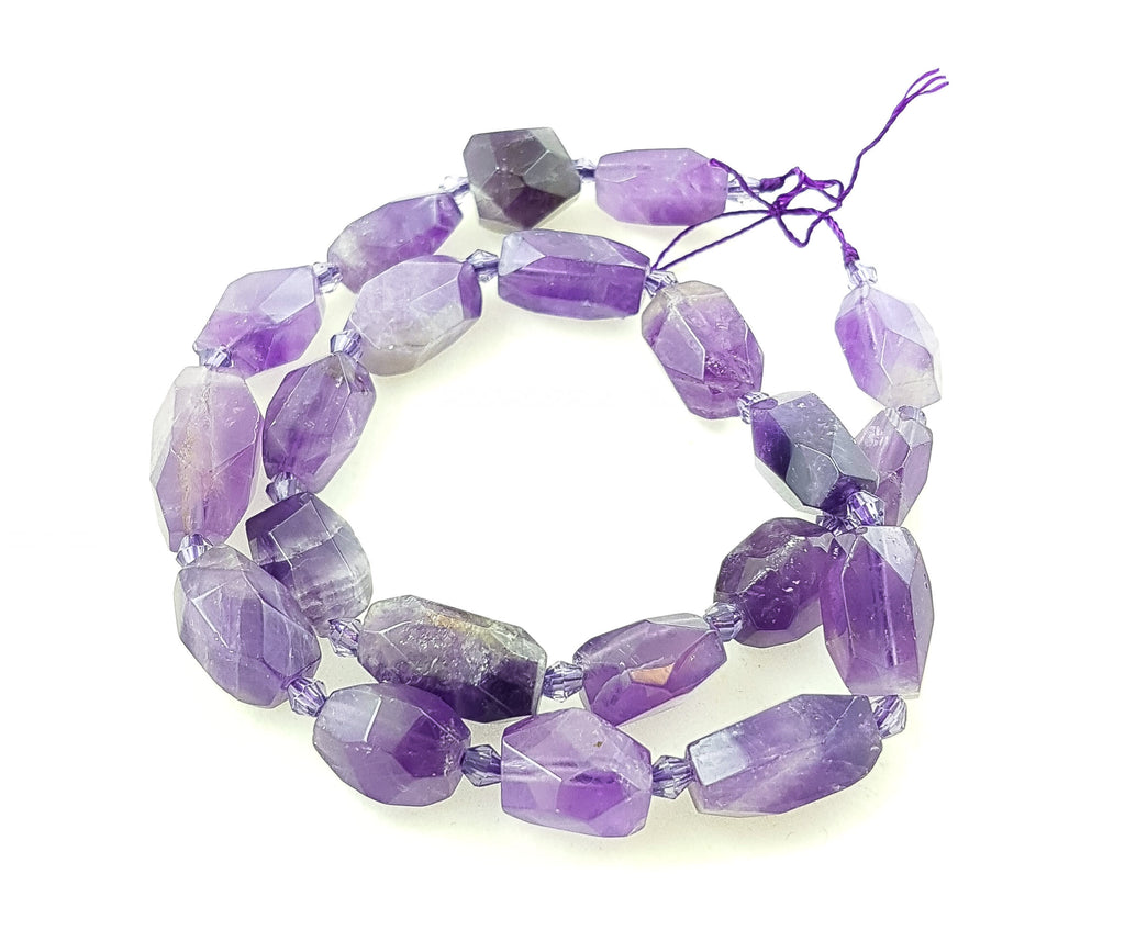 A Strand of Semi-precious Amethyst Faceted Nuggets. Approx 15mm by 12mm.