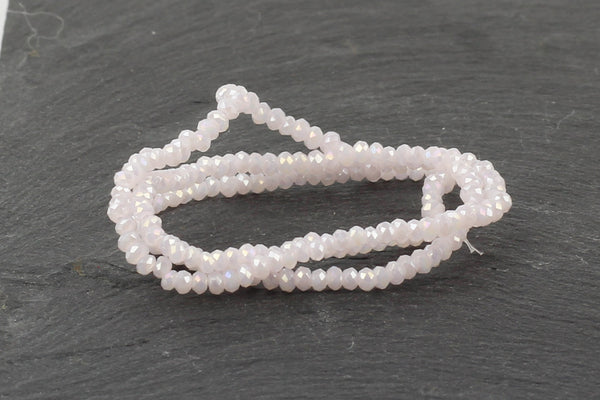 1.5mm x 2mm Very Light Pink Crystal Glass Faceted Bead Strand